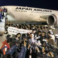 Dream boat: Japan Airlines Co. President Yoshiharu Ueki fields questions from reporters Tuesday evening after the airline's first Boeing Co. 787 jet landed at Narita International Airport. | KYODO
