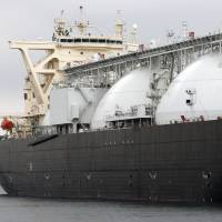 Plenty in the tank: A liquefied natural gas tanker operated by Energy Advance Co., a unit of Tokyo Gas Co., is moored at the company's plant in Sodegaura, Chiba Prefecture, in March.   KYODO