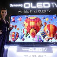 The bigger picture:  A 55-inch Samsung OLED TV is unveiled in Seoul on May 10. Sony and Panasonic have agreed to work together to develop organic light-emitting diode TVs, reversing decades of rivalry as they try to catch up with South Korea's electronics leader. | AP