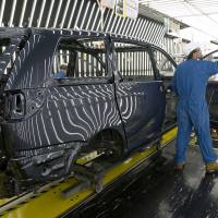 Greater than the parts: A worker assembles a car at the  Toyota plant in Princeton, Indiana, in this undated photo   BLOOMBERG
