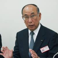 I'm on it: Oki Electric Industry Co. President Hideichi Kawasaki speaks at a news conference Wednesday at the Tokyo Stock Exchange. | KYODO
