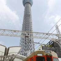 Towering achievement: A special train marking the 100th day since the opening of  Tokyo Skytree stops at  Tobu Railway Co.'s  Tokyo Skytree Station on Aug. 29.   KYODO