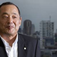 On tap:  Tsutomu Kamijo, president of Sapporo Holdings Ltd., poses for a photo  Thursday in  Tokyo.   BLOOMBERG