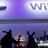 Hare-brained?: People sporting rabbit ears play with  Wii U consoles during the E3 Expo in Los Angeles on June 5. | BLOOMBERG