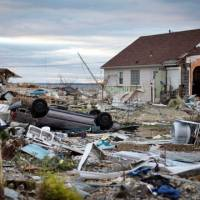 Trapped in time: Debris clogs streets and yards Saturday in Union Beach, New Jersey, five days after Superstorm Sandy swooped in to wreak widespread destruction, flooding and power outages.   BLOOMBERG