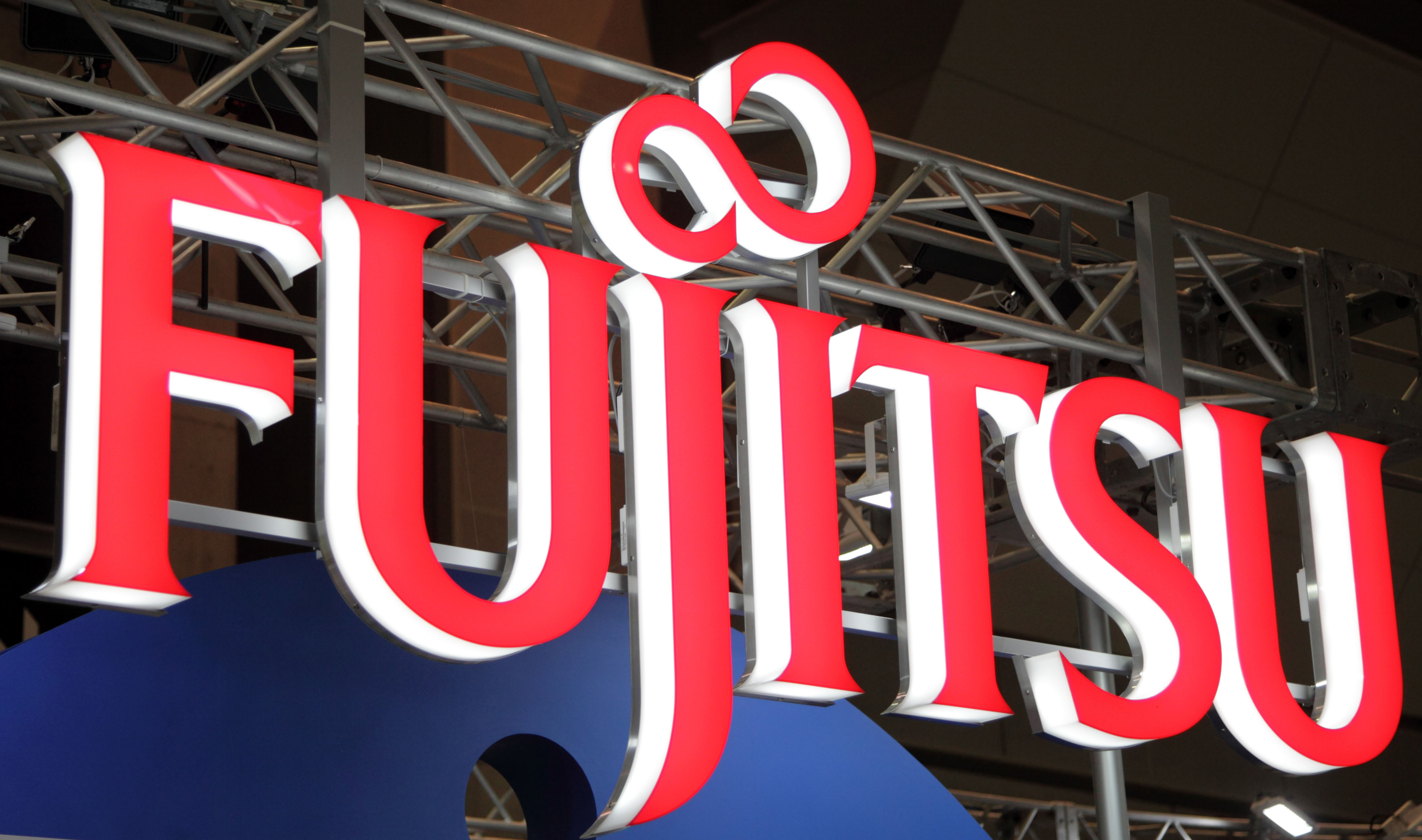 One of the players: The Fujitsu Ltd. logo is displayed at the e-Book Expo Tokyo in July. | BLOOMBERG