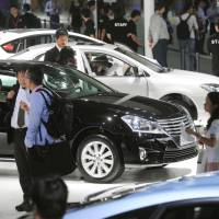 Boycott buster?: Visitors check out Toyota's booth at a motor show in Guangzhou, southern China, on Thursday. | KYODO