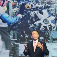 Thai ties: Toyota Motor Corp. President Akio Toyoda speaks at a ceremony Nov. 8 in Bangkok to cerebrate 50 years since the carmaker established a foothold in Thailand. | KYODO