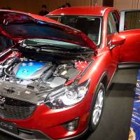 Second look: A diesel-engine CX-5 made by Mazda Motor Corp. is displayed in Tokyo's Minato Ward in February. | KYODO