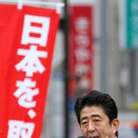 Tohoku tour: Liberal Democratic Party chief and former Prime Minister Shinzo Abe addresses a campaign rally Dec. 4 in the city of Fukushima, ahead of Sunday's election. | BLOOMBERG