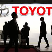 In the game: Visitors walk through the Toyota Motor Corp. display on the first day of the 83rd Geneva International Motor Show on Tuesday. | BLOOMBERG