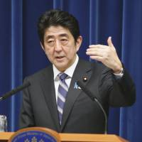 Outdoing himself: Prime Minister Shinzo Abe responds to a question during a press conference on Monday.   KYODO