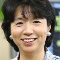 Reason to smile: Economist Hiroko Ota, who served as minister for economic and fiscal policy between 2006 and 2008, has been picked as struggling Panasonic Corp.'s first female director. | BLOOMBERG