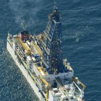 Next-generation energy source: The deep-sea drilling vessel Chikyu extracts gas from methane hydrate buried some 1.3 km below the ocean's surface off Aichi Prefecture on Tuesday.   KYODO