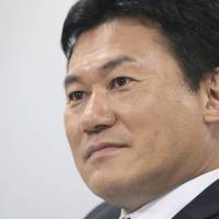 Two cents: Rakuten Co. President Hiroshi Mikitani suggests the government set clear tax and employment targets. | BLOOMBERG