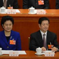 New to prime time: New Vice Premier Liu Yandong, Wang Zhaoguo, chairman of the All-China Federation of Trade Unions, and new Vice Premier Ma Kai appear at the NPC's closing session. | AFP-JIJI