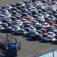 Imbalance: Cars await export in Yokohama in December. Japan recorded a trade deficit of ¥777.5 billion in February — the eighth straight month of deficit. | AP