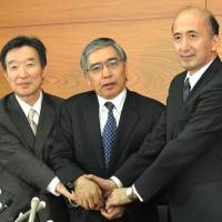 Monetary musketeers: New Bank of Japan Gov. Haruhiko Kuroda is flanked by deputies Kikuo Iwata (left) and Hiroshi Nakaso at BOJ headquarters Thursday. | AFP-JIJI