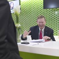 Currency imbalance: Ford Motor Co. President and CEO Alan Mulally prepares for a television interview at the Bloomberg office in Bangkok on Tuesday.   BLOOMBERG