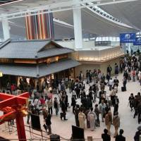 Moving up: Travelers pass through the international terminal of Haneda airport, which was rated the world's fourth-busiest airport last year, regaining a position it last held in 2008. | BLOOMBERG