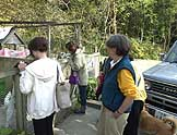 Visitors to Animal Refuge Kansai play with some of the dogs at the organization's shelter.