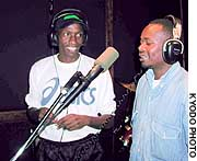 Douglas Wakiihuri (left), a former world champion marathoner, takes part in a recording session with a friend at a studio in Nairobi.