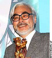 Hayao Miyazaki at a news conference in Tokyo shows off the Golden Bear trophy he won at the Berlin Film Festival for directing the animated film 'Spirited Away.'