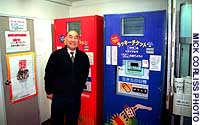 Grocer Junichiro Yasui is proud of the can and bottle recycling machines near his store.