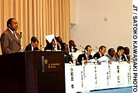 Sam Ibok, director of political affairs at the Organization of African Unity, discusses African governance issues at a recent symposium at U.N. University in  Tokyo.