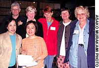 Noriko Yamaue (front, right) smiles with members of the nonprofit trust Women Welcome Women World Wide at its Nara gathering.