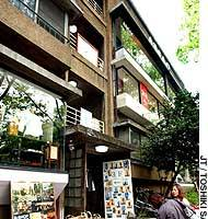 Passersby check out a boutique in the Dojyunkai Apartment complex on Omote-sando boulevard in Tokyo's Aoyama district.
