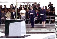 Crown Prince Naruhito and Princess Masako attend the unveiling of a monument in Kobe for the victims of the Great Hanshin Earthquake.