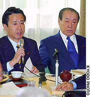 Hiroyuki Arai (left), head of an LDP policy panel that deals with postal services issues, addresses panel members in Tokyo.
