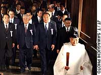 Members of a suprapartisan Diet group visit Yasukuni Shrine to observe its spring peace festival.