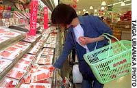 Shoppers like this one at the Jusco Yamatotsuruma supermarket in Yamato, Kaangawa Prefecture, can track products' history using a computer in the store.