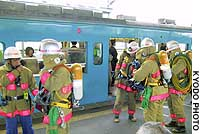 Firefighters check an East Japan Railway Co. train at JR Shin-Kiba Station after a college student used a self-defense spray inside a crowded passenger car.