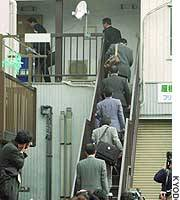 Investigators arrive to search in the head office of health food company Albien in Setagaya Ward, Tokyo.