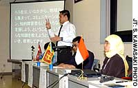 Lokesh Khadka explains in Japanese sign language the situation facing the deaf in Nepal at a recent symposium in Shinjuku Ward, Tokyo.