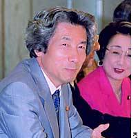 Prime Minister Junichiro Koizumi speaks to ruling coalition members on Friday.