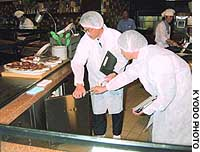 Health officials conduct a hygiene inspection at a USJ restaurant in Osaka.