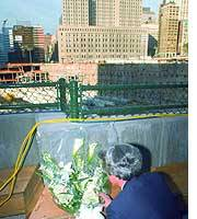 Prime Minister Junichiro Koizumi lays flowers at ground zero.