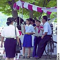 North Koreans eat ice cream on a street in Pyongyang.