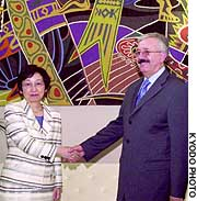 Foreign Minister Yoriko Kawaguchi (left) meets her Iraqi counterpart, Naji Sabri, prior to talks at the United Nations headquarters.