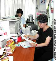 Midori Ito (left) and Keiko Tani of the Women's Union Tokyo prepare to negotiate on behalf of a female worker.
