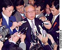 Kansei Nakano of the Democratic Party of Japan is quizzed by the media after being chosen as the party's new secretary general.