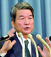 Takenaka's predecessor, Hakuo Yanagisawa, attends a news conference earlier in the day.