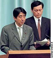 Shinzo Abe, deputy chief Cabinet secretary, announces the results of a fact-finding mission investigating Japanese nationals abducted to North Korea.
