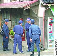 Niigata Prefectural Police inspect the area around a shop on Sado Island that Hitomi Soga reportedly visited the day she was snatched by North Korean agents in 1978.