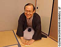 Shozo Arai,  better known as Taikomochi Arai, demonstrates the trademark wide-smile greeting he uses to welcome guests to traditional Japanese saloon parties.