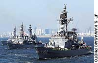 The MSDF destroyers (from foreground) Shimakaze, Yamagiri and Yugiri cruise Tokyo Bay with civilian guests aboard during an international fleet review.